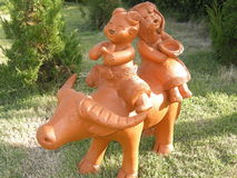 Children riding buffalo statue. Royalty Free Stock Images