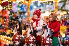 Children riding carousel on Christmas market Royalty Free Stock Photos