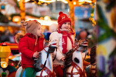Children riding carousel on Christmas market Royalty Free Stock Images
