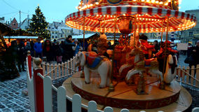Children riding on the carousel at Christmas time in Tallinn stock footage