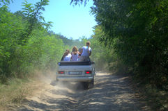 Children riding on dirt forest road Stock Photo
