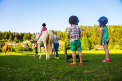 Children riding  horse Royalty Free Stock Images