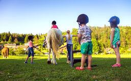 Children riding  horse Royalty Free Stock Photography
