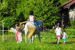 Children riding  horse Stock Photo