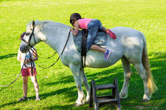 Children riding  horse Stock Photos