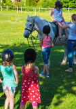 Children riding  horse Stock Photography