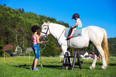 Children riding  horse Royalty Free Stock Photo