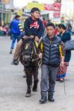 Children riding horse with tamer at Chowrasta mall in Darjeeling. India.  Stock Image