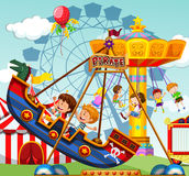 Children riding on rides at the funfair Stock Photo