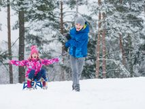 Children riding sled in winter Royalty Free Stock Photography
