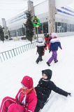 Children riding sleighs in Bucharest Stock Photography