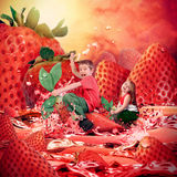 Children Riding Strawberry Fruit Landscape Royalty Free Stock Photography