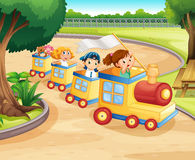 Children riding on the train in the park Stock Photo