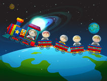 Children riding train in space Stock Photography
