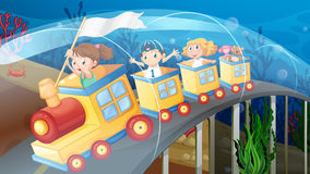 Children riding on train in the tunnel Royalty Free Stock Image