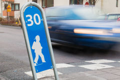 Children road crossing. Road crossing and slow zone Stock Images