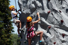 Children rock climbing Stock Image
