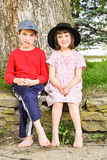 Children on a Rock Wall. Children sitting on a rock wall royalty free stock image