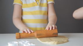 Children roll out the dough and make cookies.  stock video