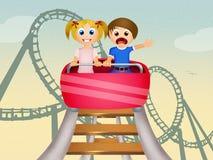 Children on roller coaster Stock Photos
