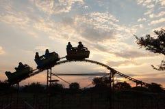 Children on a rollercoaster in Bulawayo, Zimbabwe. Children on a ride at a theme park in Bulawayo, Zimbabwe royalty free stock image