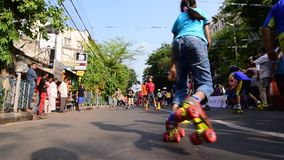 Children rollerskating on road, India, editorial stock video