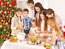 Children rolling dough in kitchen. Stock Photo
