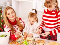 Children rolling dough in kitchen. Stock Image