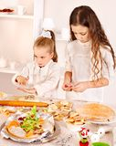Children rolling dough in kitchen. Stock Photos