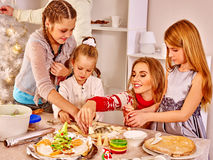 Children rolling dough in kitchen Stock Photo