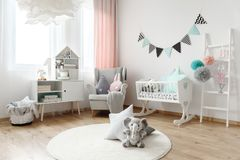 Pillows in various shapes. Children room interior decorated with stuffed animal toys, and colorful pillows that come in various shapes stock photos