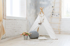 Children room in loft or rustic style. Children`s hut in the room. Wigwam for kids in rustic style. Children room in loft or rustic style Royalty Free Stock Photo