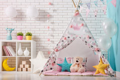 Children room with play tent stock photography