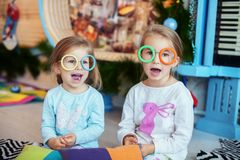 Children in the room sing. Two sisters. The concept of Christmas Stock Photos