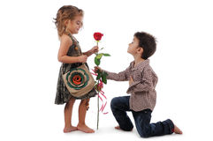 Children with rose. An enamored  boy is giving a rose to  girl Royalty Free Stock Images