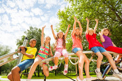 Children on round bar of playground construction stock photo
