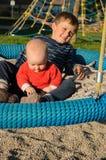 Children on round swing Stock Photo