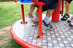 Children on a roundabout at a playground royalty free stock photo