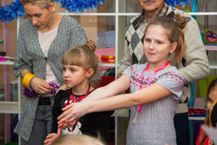 Children roundelay. Girl with Santa Claus at New year celebration in kindergarden. Krasnodar, Russia december 2014 Royalty Free Stock Photography