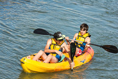 Children Rowing In Kayak Royalty Free Stock Photo