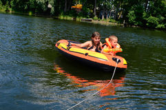 Children in a rubber boat Royalty Free Stock Photo