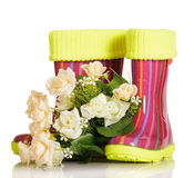 Children rubber boots with fabric insert and bouquet roses isolated. Children rubber boots with fabric insert and a bouquet of roses isolated on white Stock Photos