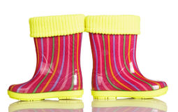 Children rubber boots with fabric inset isolated on white. Children rubber boots with fabric inset isolated on white background Stock Images