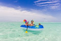 Children in rubber raft Royalty Free Stock Image
