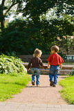 Children run away. Boy and girl join hands and run away stock photos