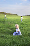 Children run on grass royalty free stock images