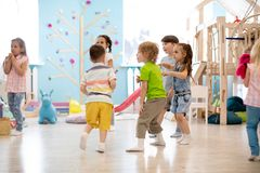 Free Children Run, Play Educational Games In Kindergarten Or Daycare Royalty Free Stock Image - 158727586