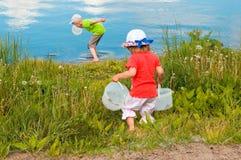 Children run for water stock photography