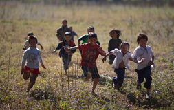 Children running. In Nepal, the mountains of the children, barefoot, slightly larger than the point home, the girls are helping with the housework. Located in Stock Image