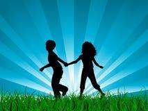 Children running. Silhouettes of children running in grass Royalty Free Stock Photography